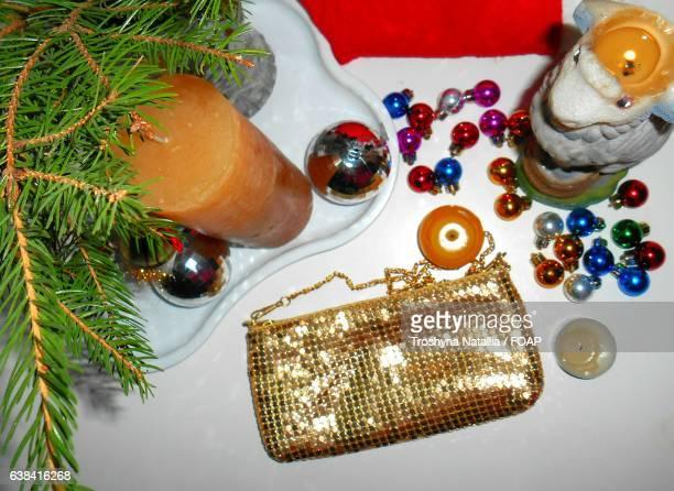 Handbag with candle and Christmas bauble