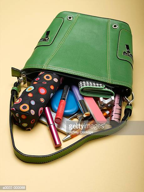 handbag with spilled contents - handbag stock pictures, royalty-free photos & images