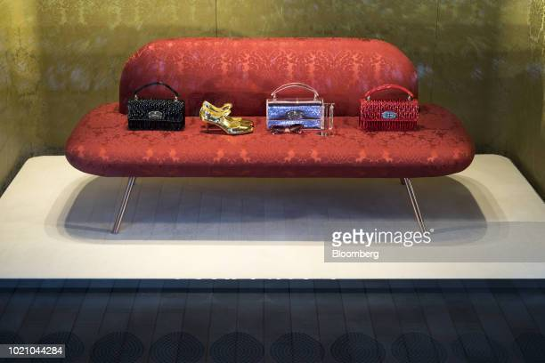 Handbags and shoes are displayed in the window of a luxury store in the Omotesando area of Tokyo Japan on Tuesday Aug 21 2018 Japan is scheduled to...