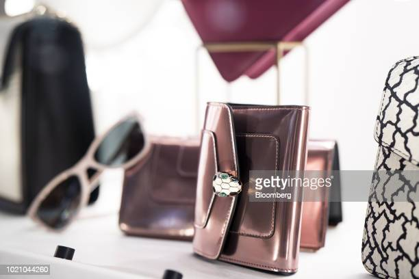 Handbags are displayed in the window of a Bulgari SpA store at night in the Ginza area of Tokyo Japan on Tuesday Aug 21 2018 Japan is scheduled to...