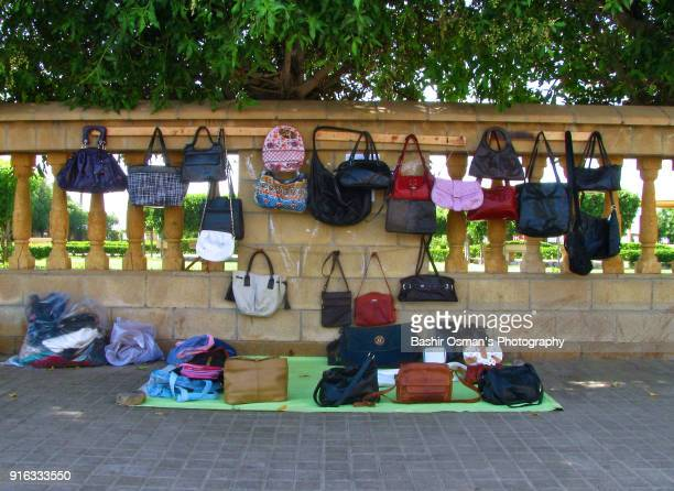 handbags are on display for sale - ricchi e poveri foto e immagini stock
