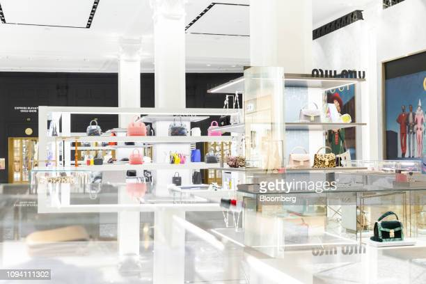 Handbags by Miu Miu brand a subsidiary of Prada SpA sit on display at the newly renovated ground floor of the Saks Fifth Avenue Inc flagship store in...