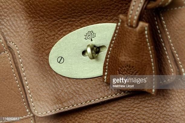 Handbags on display in the window of the Mulberry flagship retail store on New Bond Street on June 16, 2011 in London, England. The luxury handbag...