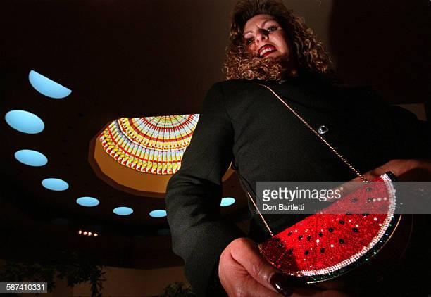 LSHandbagsLeiberDB100298––CostaMesa–– Clare Landesman–Steele models a Judith Leiber handbag called Watermelon Slice Minaudiere Hand crafted with...