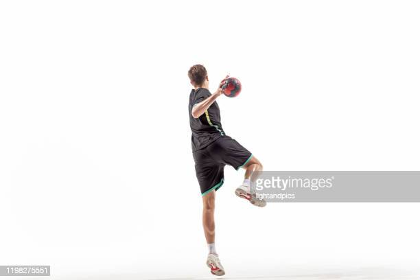 handball player in studio - handball stock pictures, royalty-free photos & images
