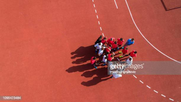 handball players consulting with coach - handball stock pictures, royalty-free photos & images