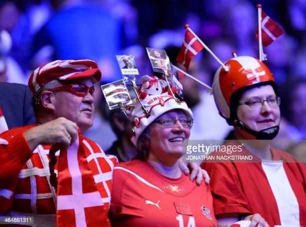 Handball supporters cheer their team during the men's EHF Euro 2014 Handball Championship semifinal match Denmark vs Croatia on January 24 2014 at...