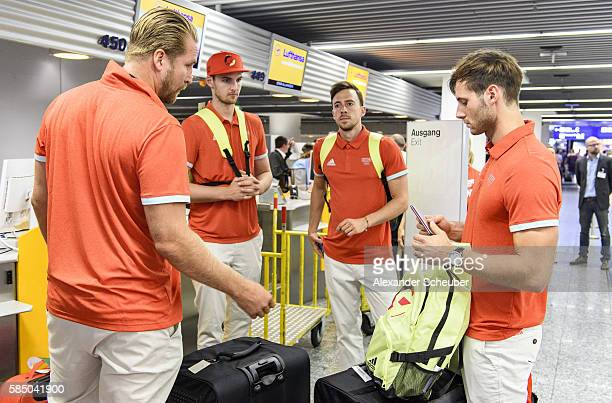 Handballer Oliver Roggisch Hendrik Pekeler Patrick Groetzki and Uwe Gensheimer during the departure of Team Germany at Frankfurt International...