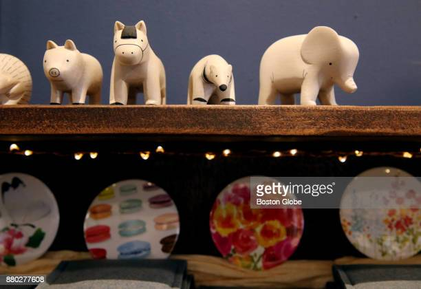 Handcarved animals from Japan are displayed at The Paper Mouse in West Newton MA on Nov 9 2017 The shop is a purveyor of fine stationery writing...