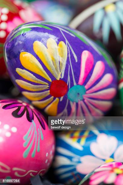 handcolored easter eggs in a basket - happy easter in russian stock pictures, royalty-free photos & images