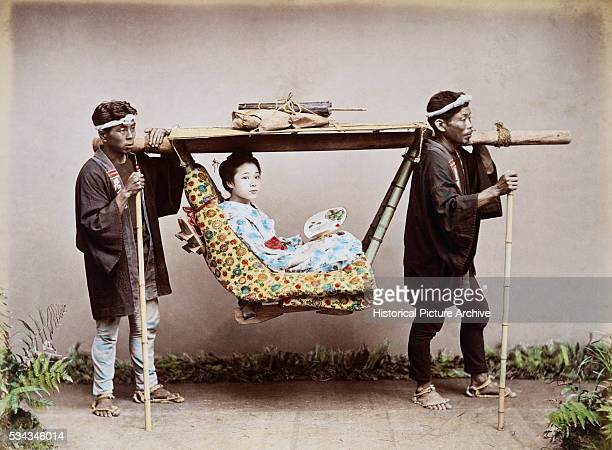 HandColored Photograph of a Japanese Geisha a Sedan Chair Attributed to Kusakabe Kimbei