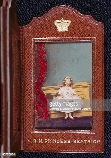 Hand-coloured carte de visite photograph in a folding presentation case, by John Mayall of 224 Regent Street, London, showing Queen Victoria's...