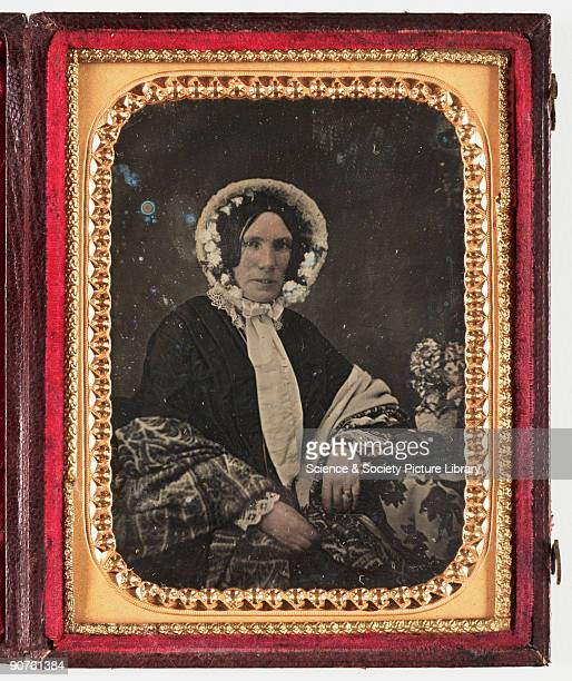 A handcoloured daguerreotype portrait of a rather severelooking woman in bonnet and shawl taken by an unknown photographer in about 1855 In 1839 the...