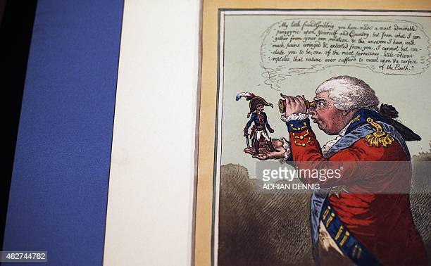 A handcoloured etching published in 1803 shows Napoleon Little Boney in the hand of King George III on display at an exhibition Bonaparte and the...