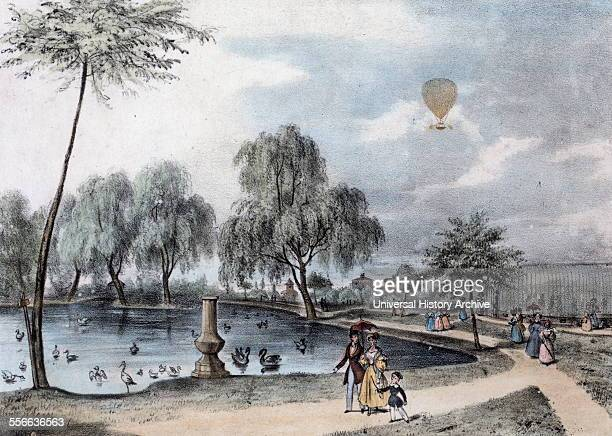 Handcoloured lithograph of the Surrey Zoological Gardens with a balloon ascending in the distance commemorating the 17th birthday of Princess...