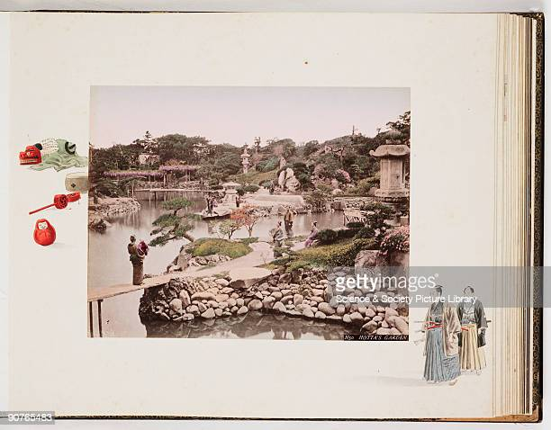 Handcoloured photograph displayed on an album page of people relaxing in Hotta Masayoshi's formal garden in Tokyo Many of the elements of a typical...