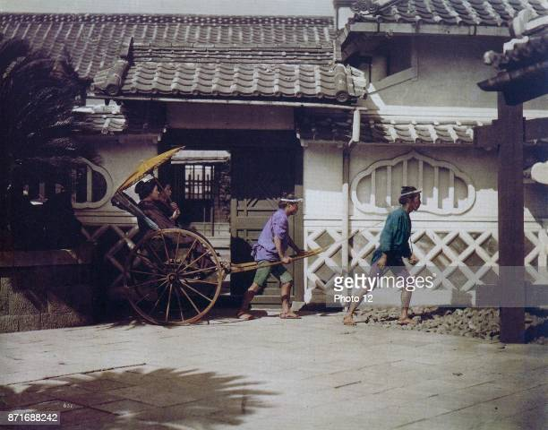 Handcoloured photograph of Japanese women being carted around by Felice Beato ItalianBritish photographer Dated 1869