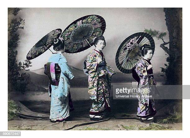 Hand-coloured photograph of Japanese women by Felice Beato Italian-British photographer. Dated 1869.