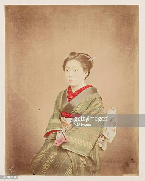 Handcoloured photographic portrait of a woman in traditional Japanese dress
