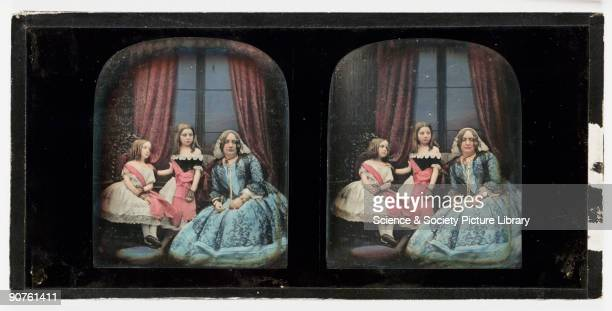 A handcoloured stereoscopic daguerreotype of a woman with two young girls taken at the studio of Antoine Claudet Born in Lyons France Claudet moved...
