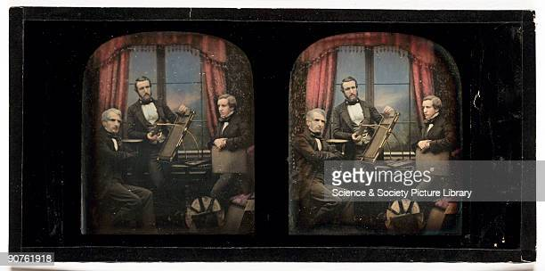 A handcoloured stereoscopic daguerreotype of Antoine Claudet and his sons posed with daguerreotype apparatus taken at the studio of Antoine Claudet...