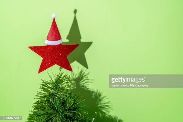 handcrafted christmas tree against green background - star shape stock pictures, royalty-free photos & images