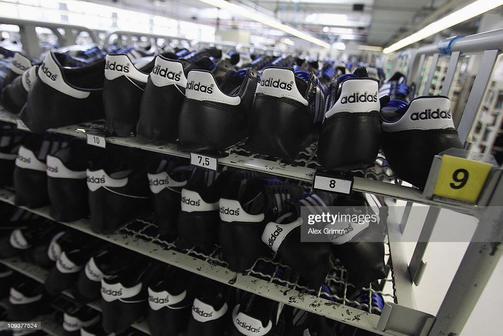 Handcrafted football boots stand in a rack at the factory of German sporting-goods maker Adidas AG on February 23, 2011 in Scheinfeld, Germany. The world's second biggest sports equipment and clothing maker, adidas, will present its 2010 result during a press conference on March 2, 2011.