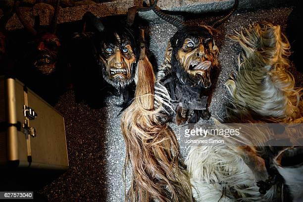 Handcrafted Krampus masks lie in the snow as participants dress as the Krampus creature prior to Krampus night on December 2 2016 in Neustift im...
