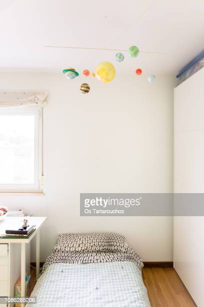 handcrafted solar system mobile in kid room - mobile stockfoto's en -beelden