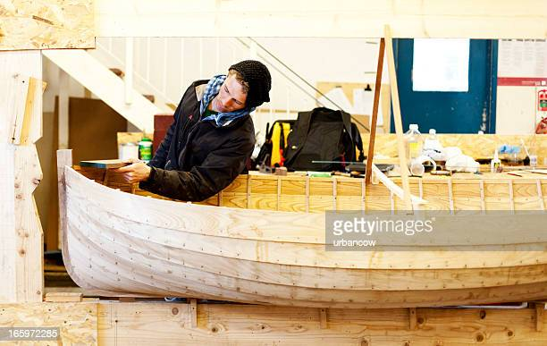 Handcrafting a wooden rowing boat