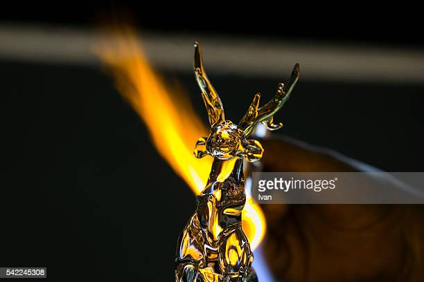handcrafting process of glass artist making shape, melting and casting with blow torch - murano stock pictures, royalty-free photos & images