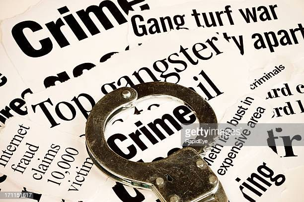 handcuff highlights 'crime' in a series of articles on criminality - gang stock pictures, royalty-free photos & images