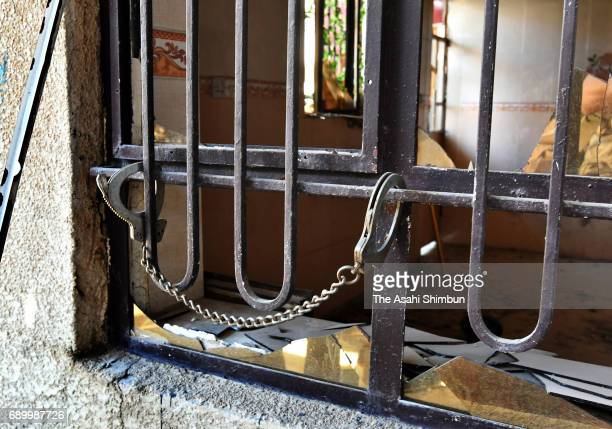 A handcuff which is belived to have been used to torture is tied at bars of the window of a house at the area freed from the Islamic States on May 24...