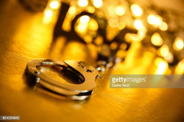handcuff with defocused word love
