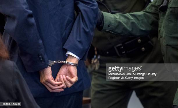 A handcuffed Andrew Urdiales an eighttime serial killer is lead by Orange County Sheriff deputies from superior court in Santa Ana after Orange...