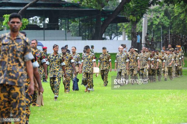 Handcuffed Bangladesh Rifles headquarter battalion soldiers walk to special court at BDR headquarters in Dhaka on July 12 2010 Seventyfour people...