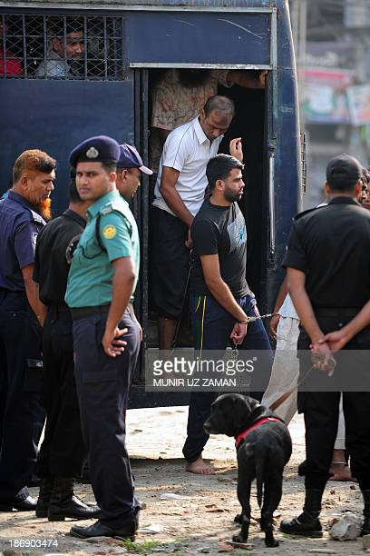 Handcuffed Bangladesh Rifles soldiers arrive at the special court in Dhaka on November 5 2013 Some 800 Bangladeshi soldiers appeared in a huge...