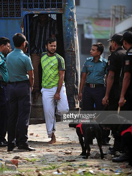 Handcuffed Bangladesh Rifles soldiers arrive at the special court in Dhaka on November 5 2013 A Bangladeshi court sentenced at least 150 soldiers to...