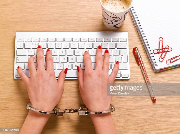 handcuffed businesswoman - punishment of slaves stock photos and pictures
