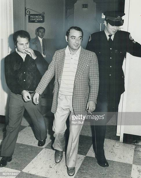 Handcuffed lathing contractor Cesidio Romanelli and an employee of his Natale Luppino of Burlington leave provincial court yesterday remanded on...