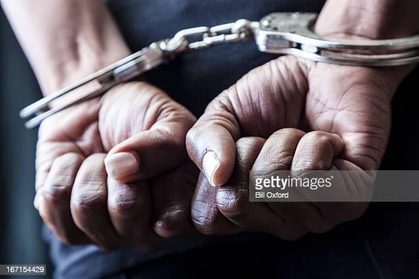 handcuffed - arrest stock pictures, royalty-free photos & images