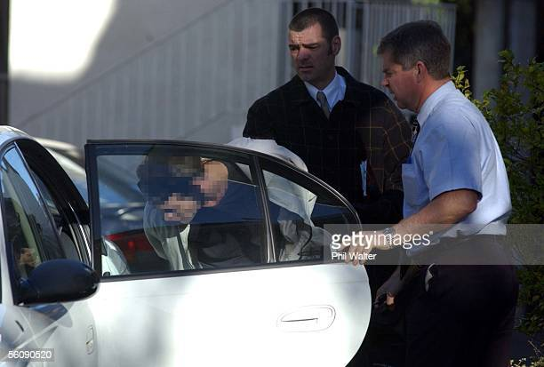 A handcuffed suspect is put into a police vehicle outside an apartment in Parnell after an early morning drugs bust on a suspected Methamphetamine...