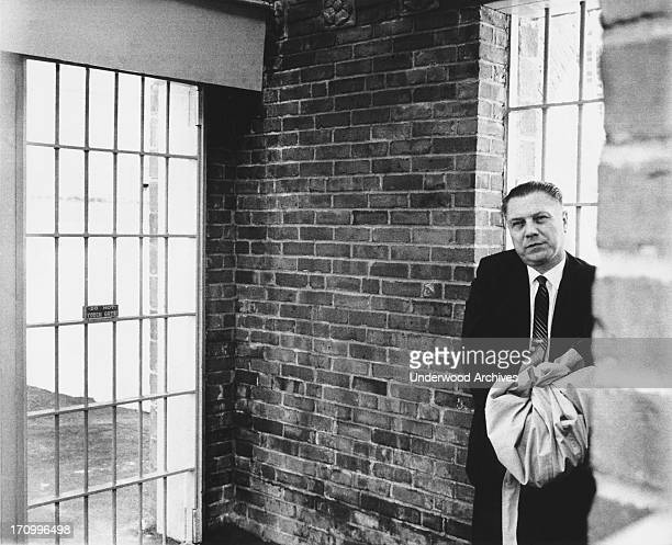 Handcuffed Teamster leader Jimmy Hoffa as he waits for the next door to open at Lewisburg Federal Prison where he will serve his eight year sentence,...