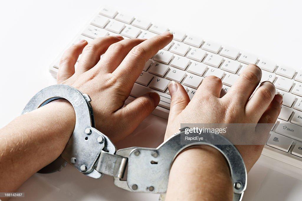 Handcuffed to her computer: very demanding job or censorship : Stock Photo