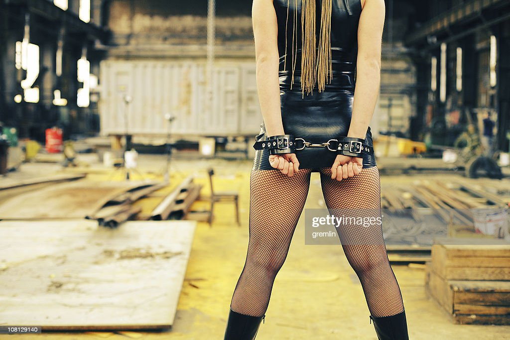 Handcuffed Young Woman in Abandoned Factory : Stock Photo