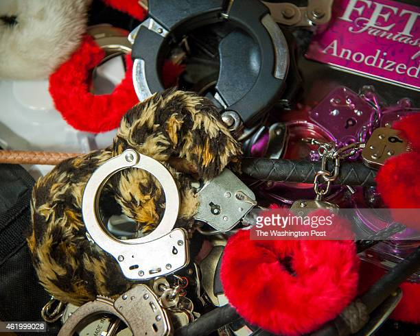 Handcuffs, both metal and furry are prohibited TSA items that ended up at the surplus store January 6, 2015 in Harrisburg, PA.