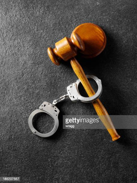 Handcuffs with a Gavel and Mallet
