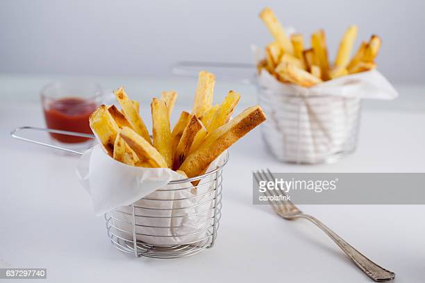 hand-cut french fries - carolafink stock photos and pictures