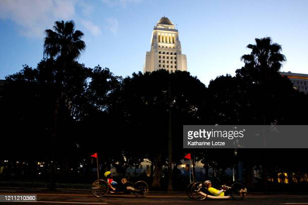 Handcyclists move down 1st Street near City Hall during the 2020 Los Angeles Marathon on March 08 2020 in Los Angeles California