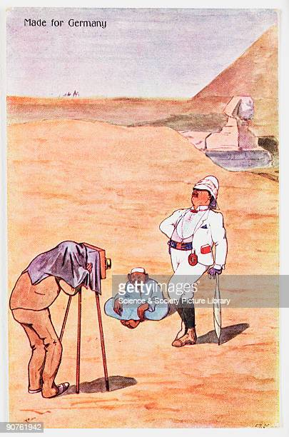 A handdrawn comic postcard by an unknown artist depicting a European tourist being photographed in front of the Great Sphinx and the pyramids An...